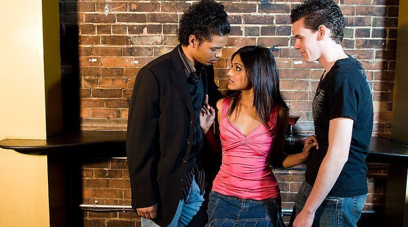 girl-flirting-with-two-guys